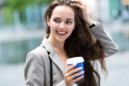 go: Woman with coffee to go