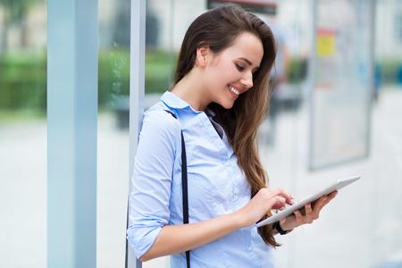 woman stop: Woman waiting at bus stop