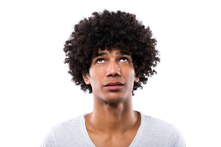 Man with afro hair looking up Banque d'images