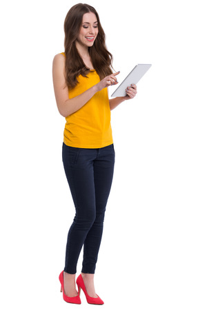 young woman smiling: Young woman using digital tablet Stock Photo