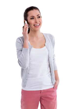 woman at the phone: Young woman using mobile phone