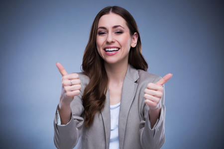 thumbs up: Young woman with thumbs up Stock Photo