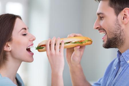 adult sandwich: Couple Sharing Sandwich