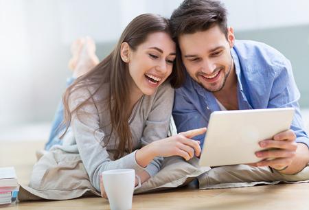 Couple using digital tablet together 写真素材