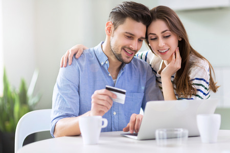 Couple using laptop together Standard-Bild