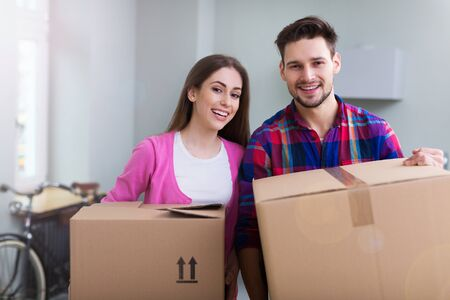 unpacked: Couple with unpacked boxes in new home