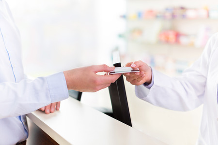 overdraft: Paying in the Pharmacy Stock Photo