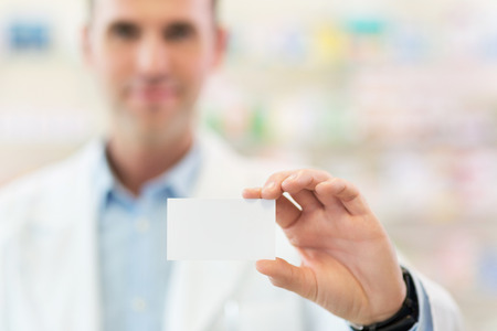 credit cards: Pharmacist holding blank card