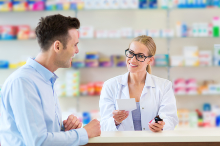 Pharmacist and client at pharmacy Banco de Imagens - 56704684