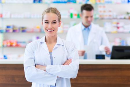 Female and male pharmacists in pharmacy