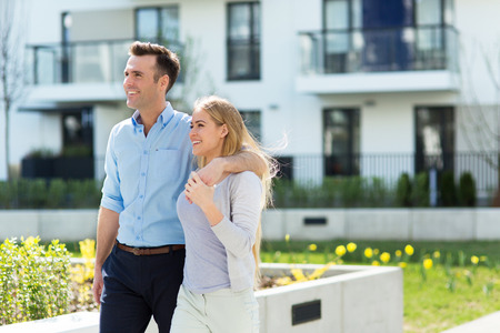 residential: Young couple in modern residential area
