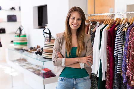 Sales assistant in clothing store Standard-Bild