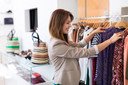 woman clothes: Woman shopping in a boutique