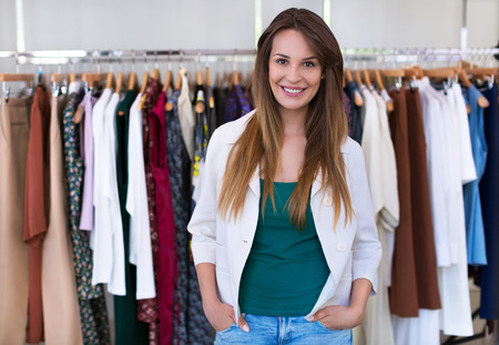 sales assistant: Sales assistant in clothing store Stock Photo