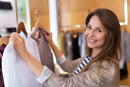 clothing shop: Sales assistant in clothing store Stock Photo