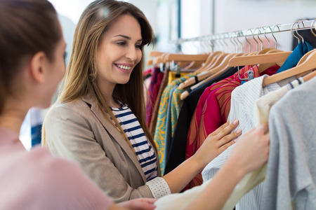 woman clothes: Women shopping in a clothing store