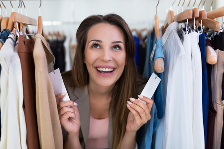 clothing store: Woman shopping in a clothing store