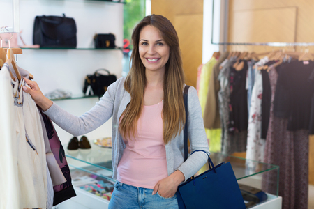 boutique: Woman shopping in a clothing boutique