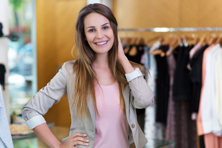 clothes rail: Woman in her clothing boutique
