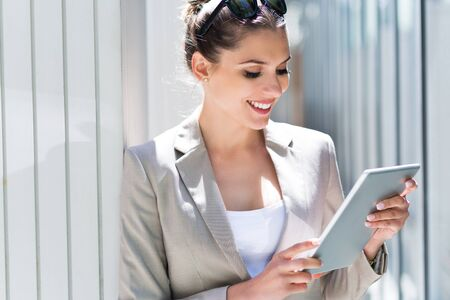 digital tablet: Attractive young woman using digital tablet Stock Photo