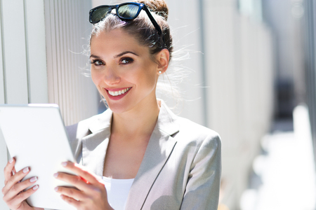 executive woman: Attractive young woman using digital tablet Stock Photo