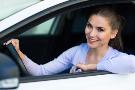 annuities: Young woman sitting in a car