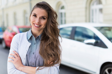 young woman smiling: Smiling car owner