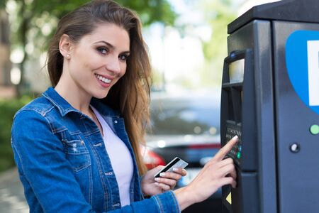 paying: Woman paying for parking Stock Photo