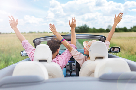 getting away from it all: Happy Couple Driving in Convertible Stock Photo