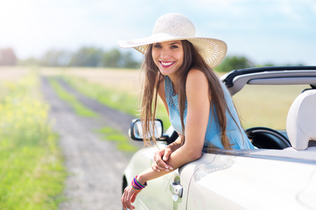 getting away from it all: Woman in convertible Stock Photo