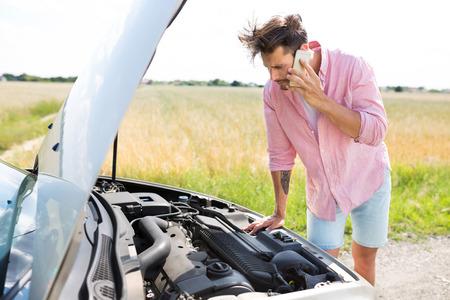 broken down: Man with Broken Down Car