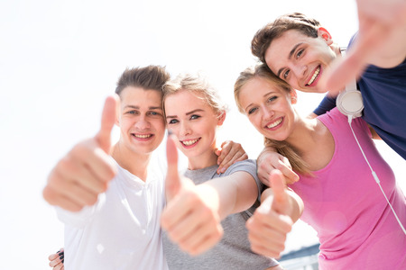 Friends showing thumbs up sign Stockfoto