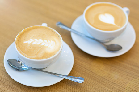 coffee cups: Two cups of coffee
