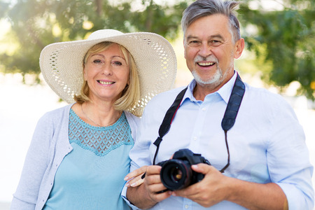 Mature couple with digital camera