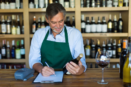 shop skill: Wine Shop Owner Stock Photo