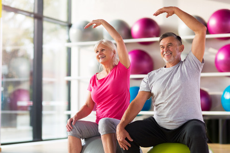 Senior couple exercising in gym Stock fotó