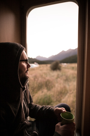 Man seated in a camper van in New Zealand photo