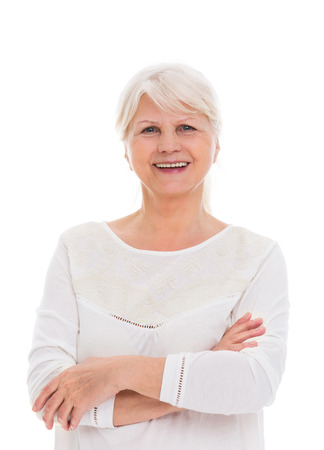 aging: Happy senior woman smiling at the camera