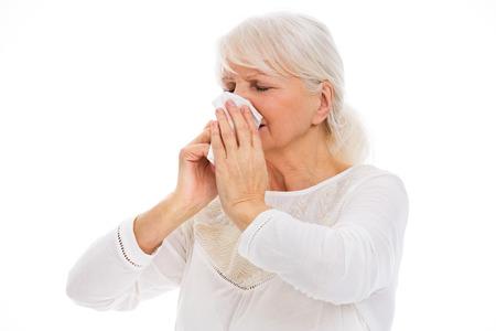 Senior woman blowing her nose Zdjęcie Seryjne
