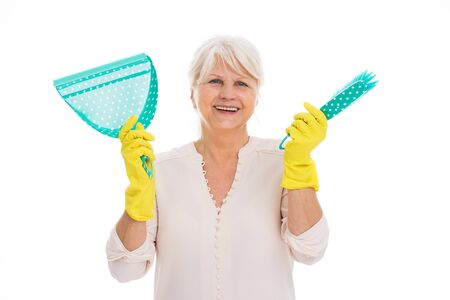 Senior woman with cleaning supplies and rubber gloves