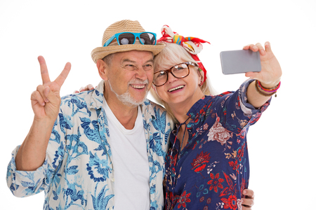 Smiling senior couple make a selfie 免版税图像