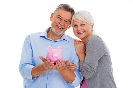 Senior couple holding a piggy bank