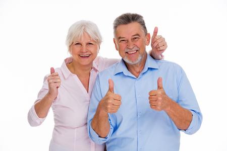 Senior paar zien thumbs up Stockfoto - 76679664