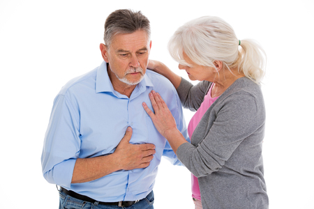 Woman helping man with chest pain