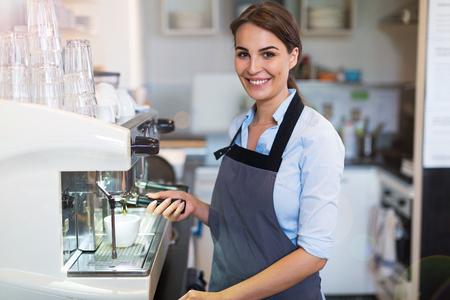 Woman working in coffee shop 版權商用圖片