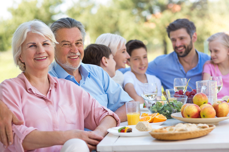 Extended family eating outdoors Stock Photo