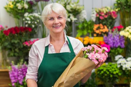 Senior woman working in florist shop