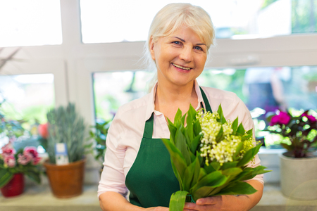 retirees: Happy owner of a flower shop Stock Photo