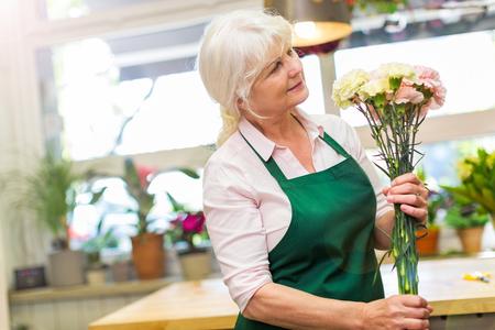 retirees: Woman working in florist shop