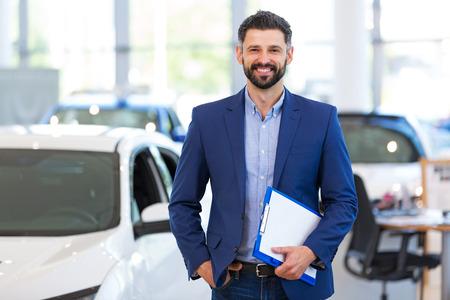 Car dealer in showroom Banco de Imagens - 80528714
